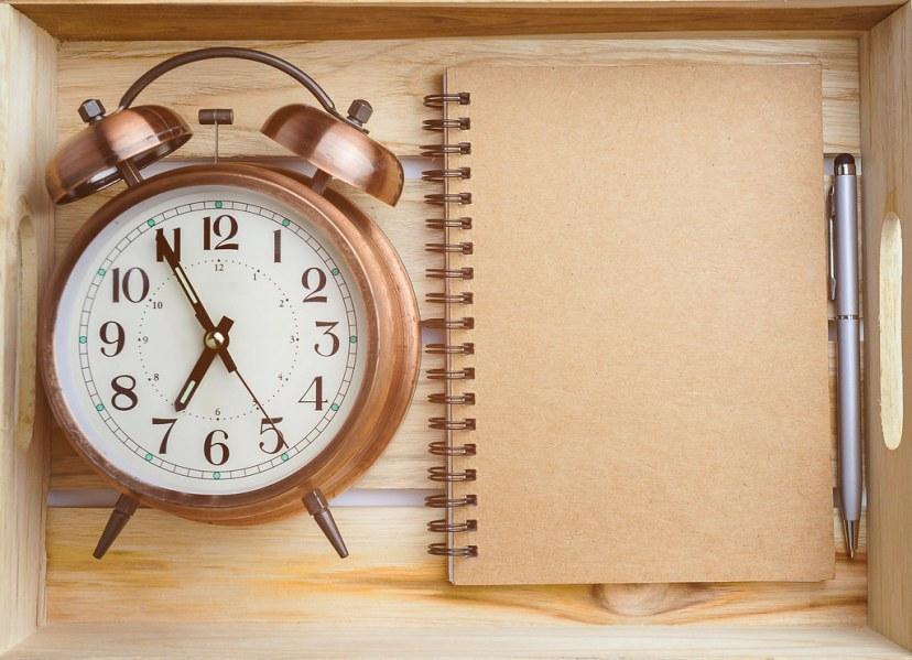 vintage alarm clock, pen and notepad in wooden crate (sinsu1980) by sinsu1980 (flickr)